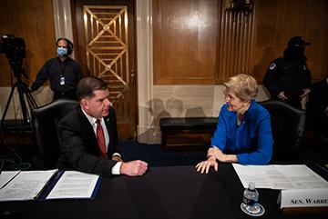 Labor secretary nominee Marty Walsh speaks with Senator Elizabeth Warren (D-MA) at his confirmation hearing.